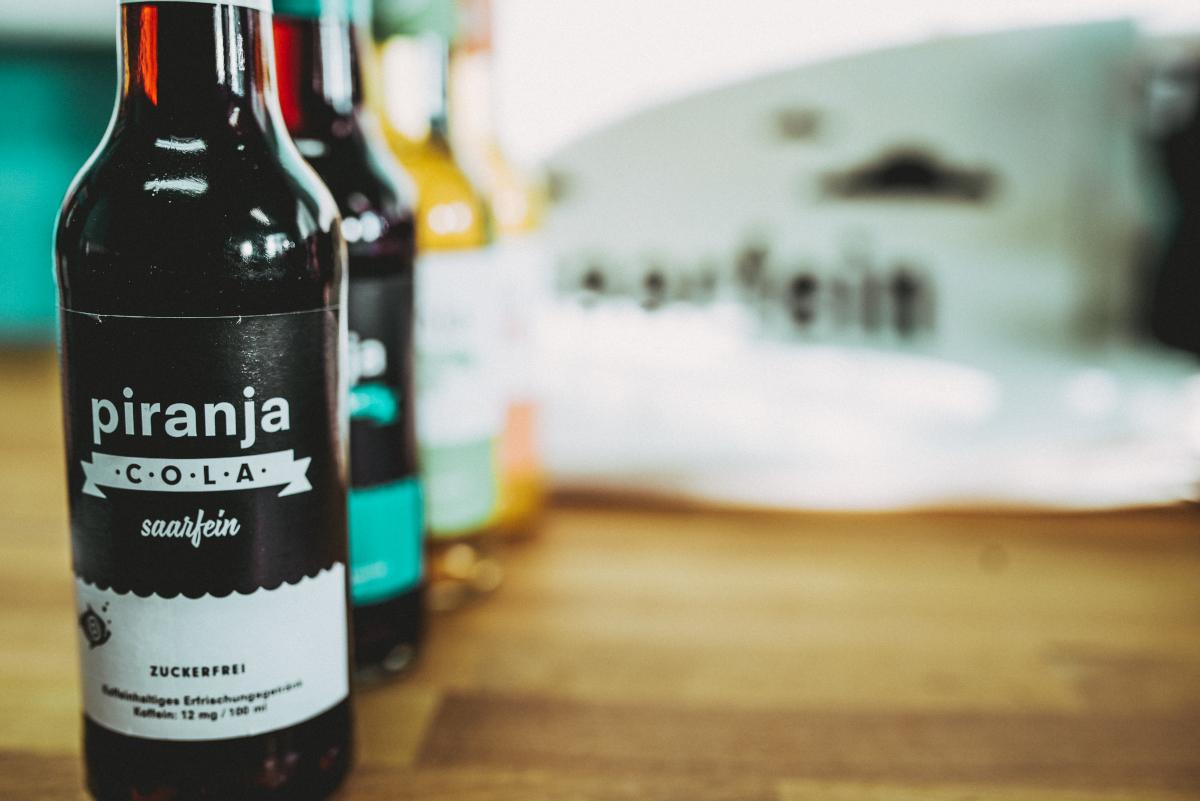 Mit Cola hat piranja-cola damals angefangen - heute gibt es drei Sorten: Cola, Cola Kirsche und Cola zuckerfrei